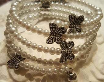 Memory wire bracelet with pearl beads and butterfly spacers