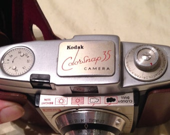 Kodak Colorsnap 35 Camera complete with the original hard case. 1950's Photography Camera and in good used condition.