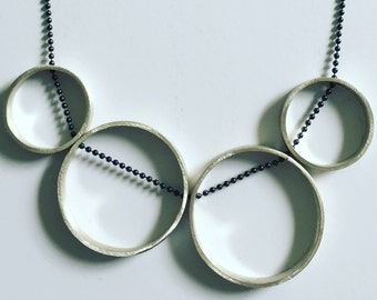 4 ring brushed Sterling Silver with oxidised chain