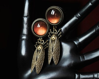 16mm beetle cicadas of plugs with red and gold stone