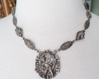 Antique Peruzzi Style Reinassance Revival Flowers and Cherubs Pendant Necklace.