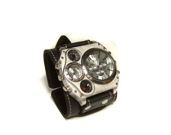 Huge wrist watches made of black leather in industrial style, with compass