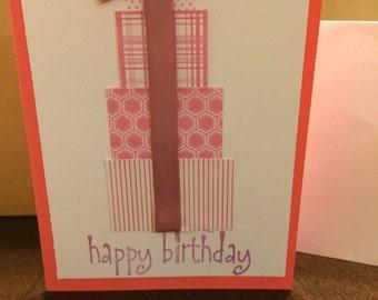 Handmade pink pile of presents birthday card