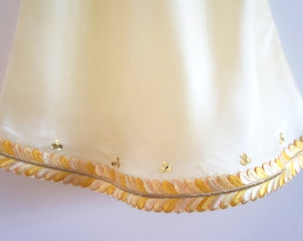 Pale yellow silk slip dress with yellow Indian trim and hand sewn sequins