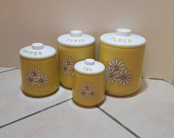 set of 4 vintage tin and plastic yellow canisters with daisies