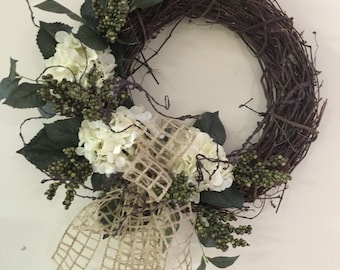 Grapevine wreath with white hydragenas