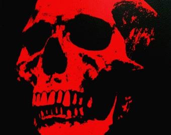 Skull screen print on wood panel.
