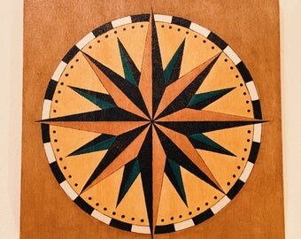 Compass rose on wooden board - Pyrography