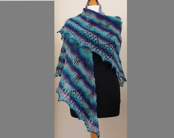Hand knitted warm lace shawl
