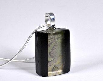 Black and antique green fused glass pendant.
