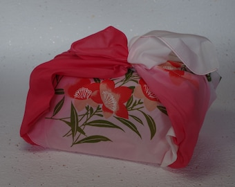 FUROSHIKI(風呂敷)a square of cloth for wrapping. It has fancy designs on it and can be folded small not in use. This is useful. Shipping  FREE!