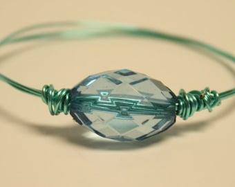 Light blue wire bangle bracelet