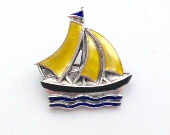 A Vintage enamelled silver yacht brooch