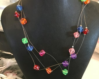Multi-strand floating dice necklace