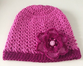 Crochet purple hat with flower