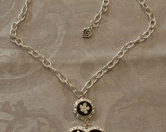 Black heart pendant necklace with flowers