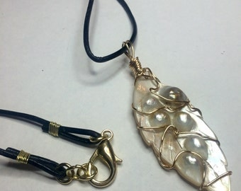 Shell pendant on leather cord