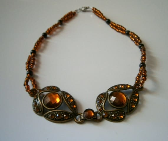 Beaded Necklace: Double Standed Brown Topaz Beaded Necklace with Bronze Colored Metal Pendant