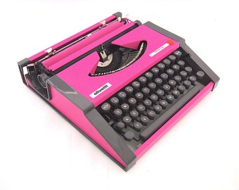 Olivetti Tropical, pink typewriter, late 1960's, custom made typewriter, in working state, portable typewriter, working typewriter, vintage.