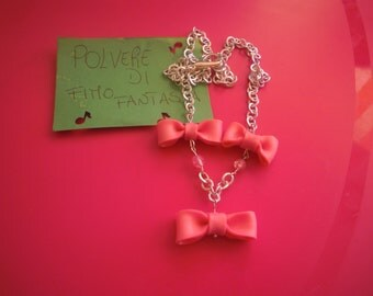Necklace with pink bows