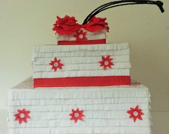 White and red cake pinata