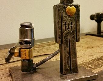 Romantic sad robot hand forged