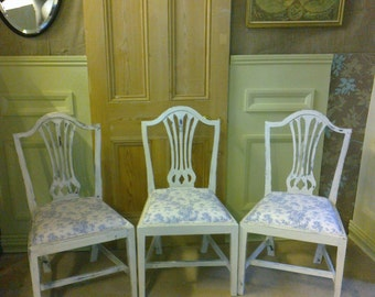A set of six painted dining chairs