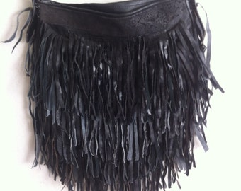 Woman black leather bag with fringe