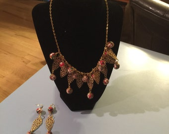 Red & Gold Metal Beads With leaf Accents