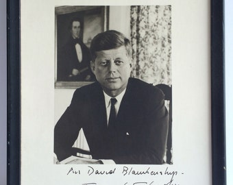 JFK signed photo in a frame