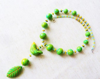 Green and yellow collar in polymer, polymer clay, glass beads from Bohemia, in rock glass