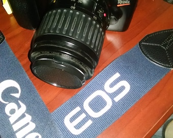 Canon EOS Rebel with sling and 35-80mm zoom lens