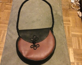 small black and brown leather bag
