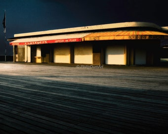 Midnight in Deauville, Normandy landscape, France, the Deauville boardwalk, beach shop, color photography, night light, Edward Hopper style