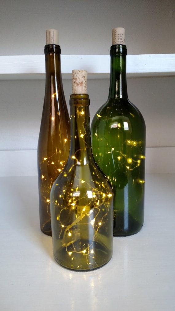 Items similar to led fairy lighted bottles green for Wine bottle patio lights