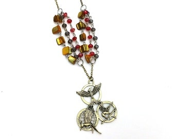 """Girl on Fire Mockingjay Hunger Games Inspired Glass Beaded Charm 26"""" Chain Necklace Bronze Tone"""
