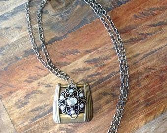 Brass buckle necklace