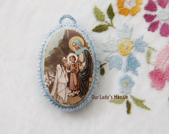 Large Catholic Agnus Dei Badge with Picture of a Girl Receiving the Holy Eucharist from Jesus