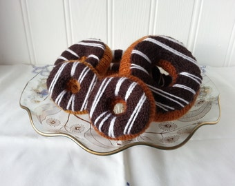 Doughnut chocolate icing with white drizzle