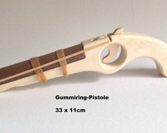 Rubber band gun made of wood for children