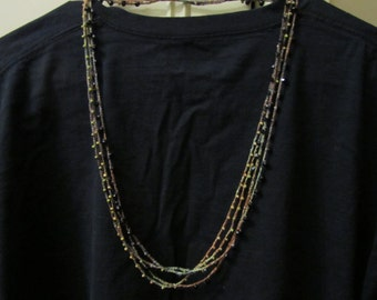 Crocheted necklace with beads black brown olive green