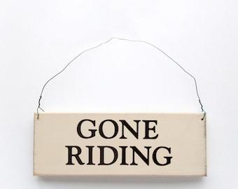 Wood sign saying: Gone Riding