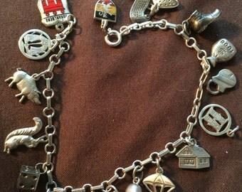 Vintage German Silver 800-835 Charm Bracelet with 18 vintage Charms