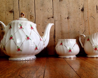 Pale pink Sadler rosebud teapot, creamer and sugar bowl set made in England, vintage tea set