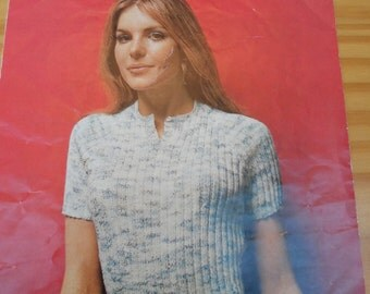 Original vintage knitting pattern for a short sleeved ribbed sweater with buttons at neck opening