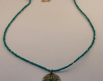 Gold sea dollar necklace