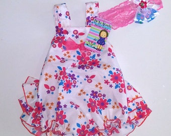 Baby girl romper dress and headband.  Size: 0-6 months.