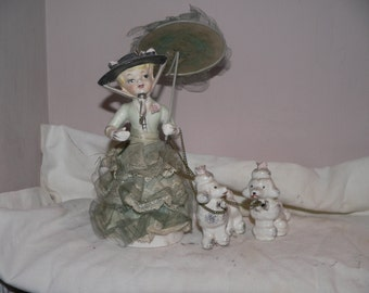 Ceramic and lace Lady and her poodles