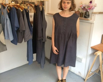 Sleeveless buttondown linen dress in grey