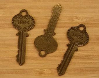 20 key charms, 1964 key pendants
